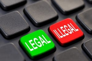 Close up of green legal and red illegal keys on a computer keyboard